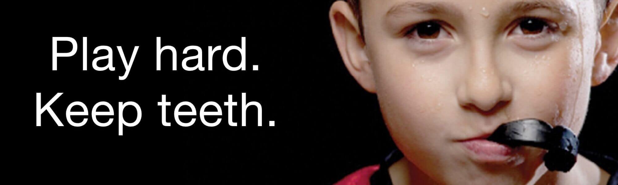 play hard and keep teeth using a sports guard