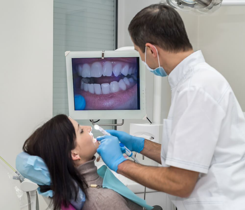 dentist using intra oral camera on patient